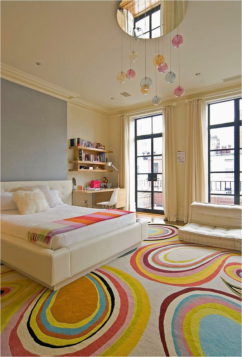 Contemporary kids bedroom inside New York home with fashionable rug