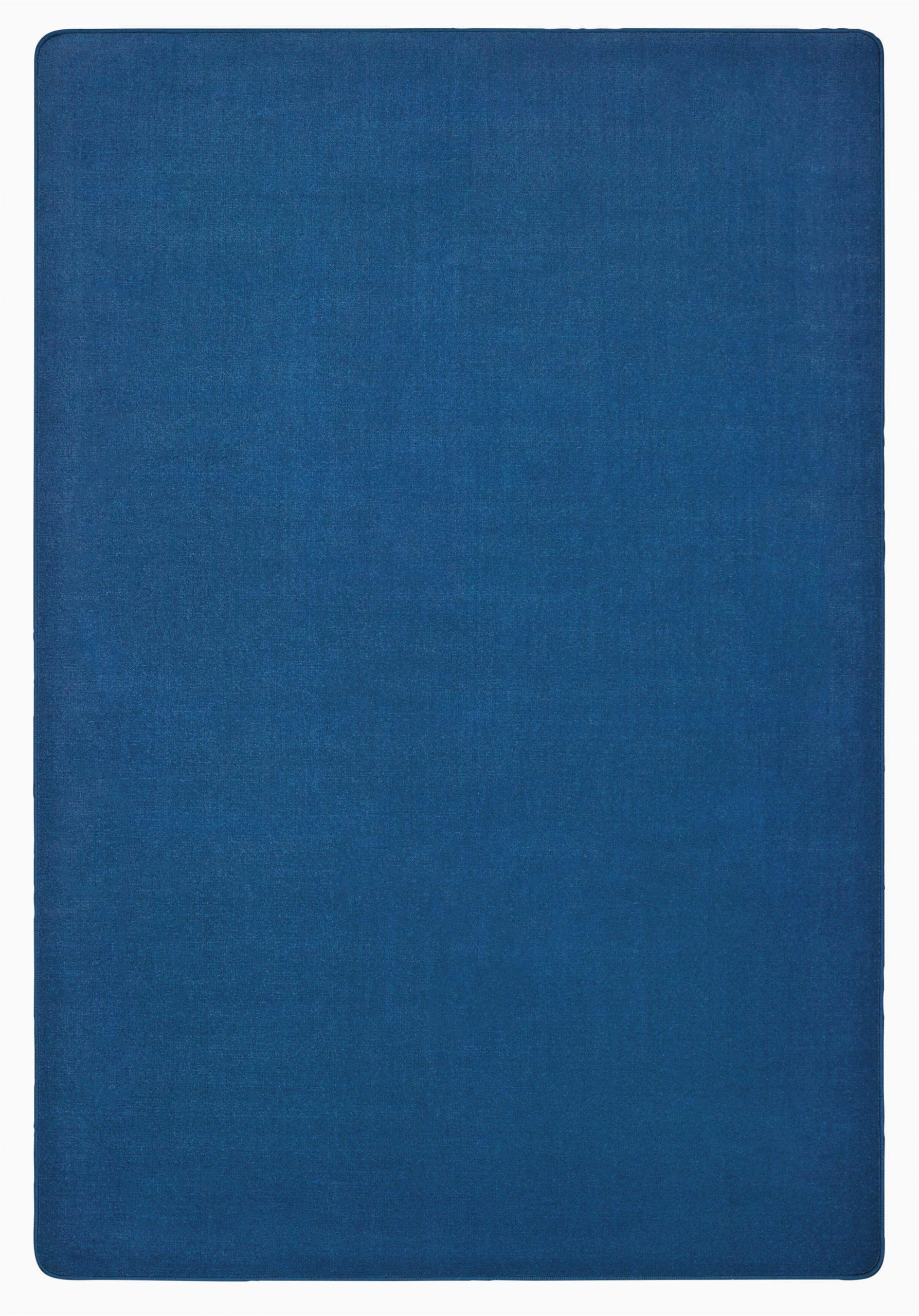 solid tufted blue skies area rug