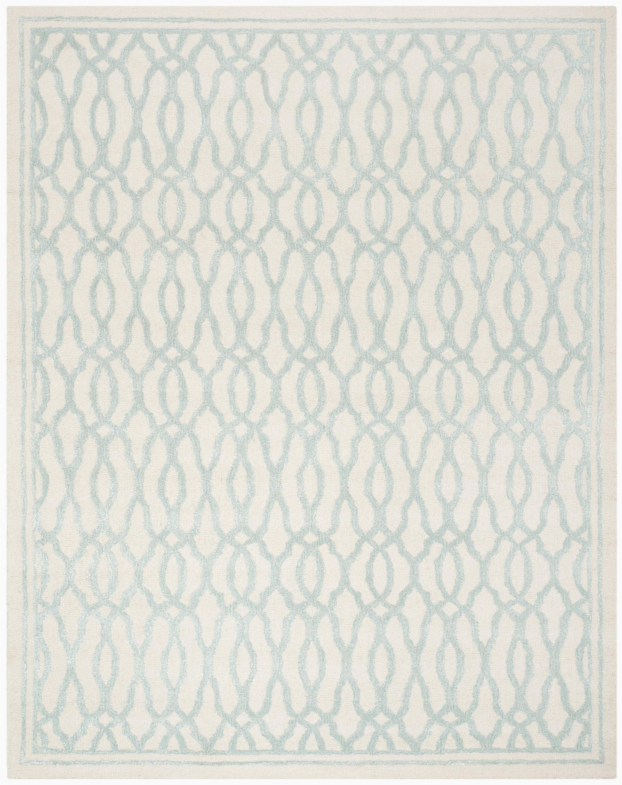 martha stewart hand tufted ivoryteal blue area rug