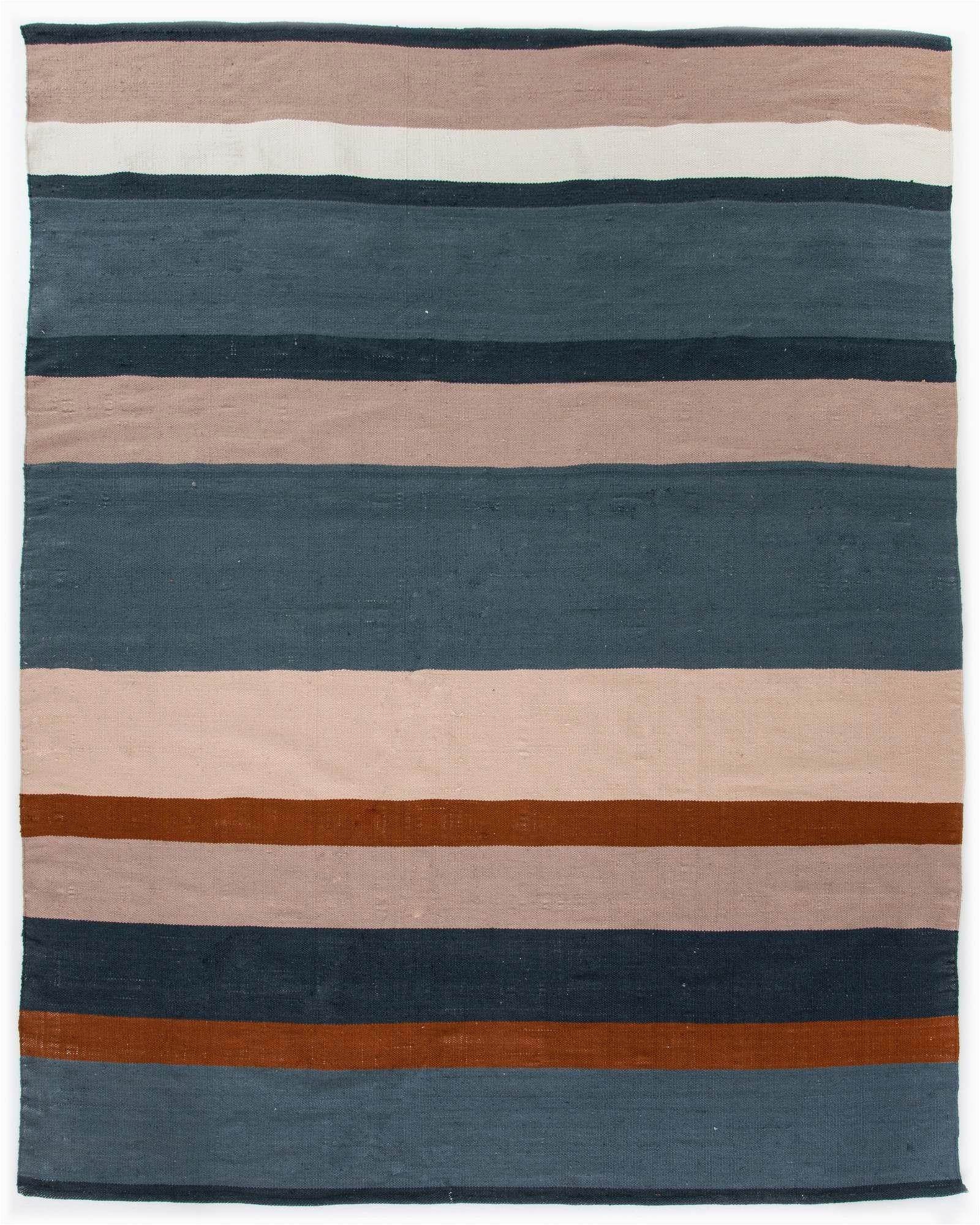 senna outdoor rug in navyorangeblush in 5x8