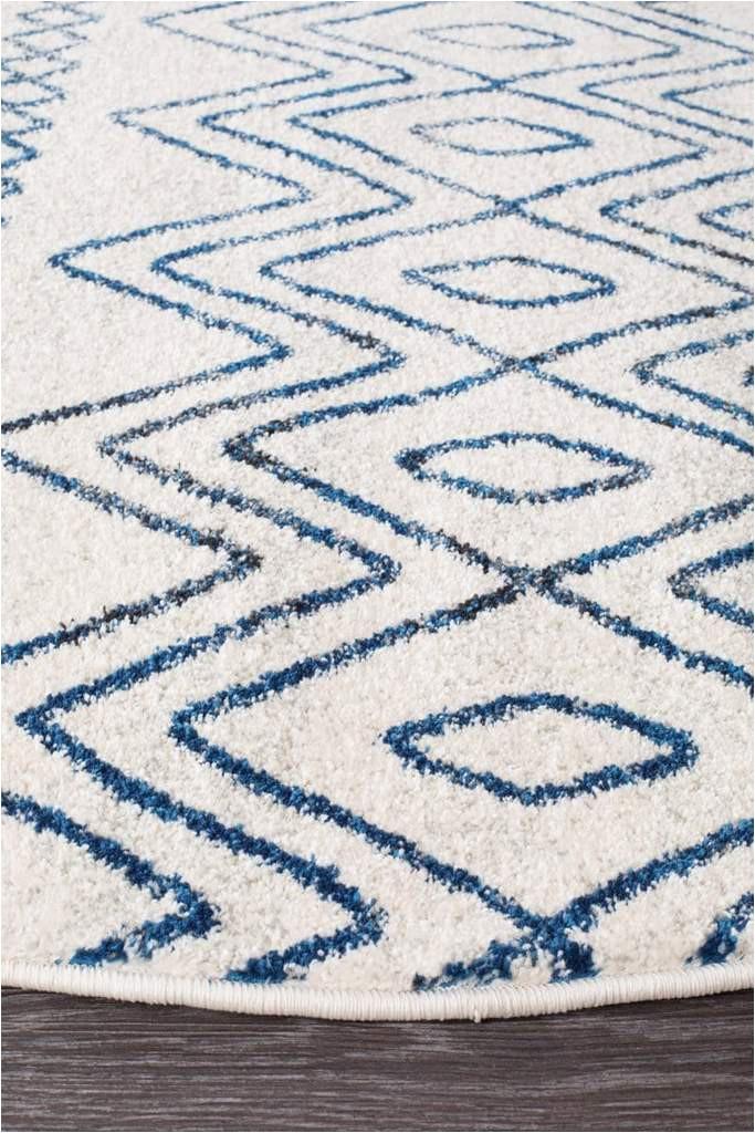 newport navy white tribal pattern round rug side 33f814ee 8c5c 45b9 aca4 445cb9dbafbd 1024x1024