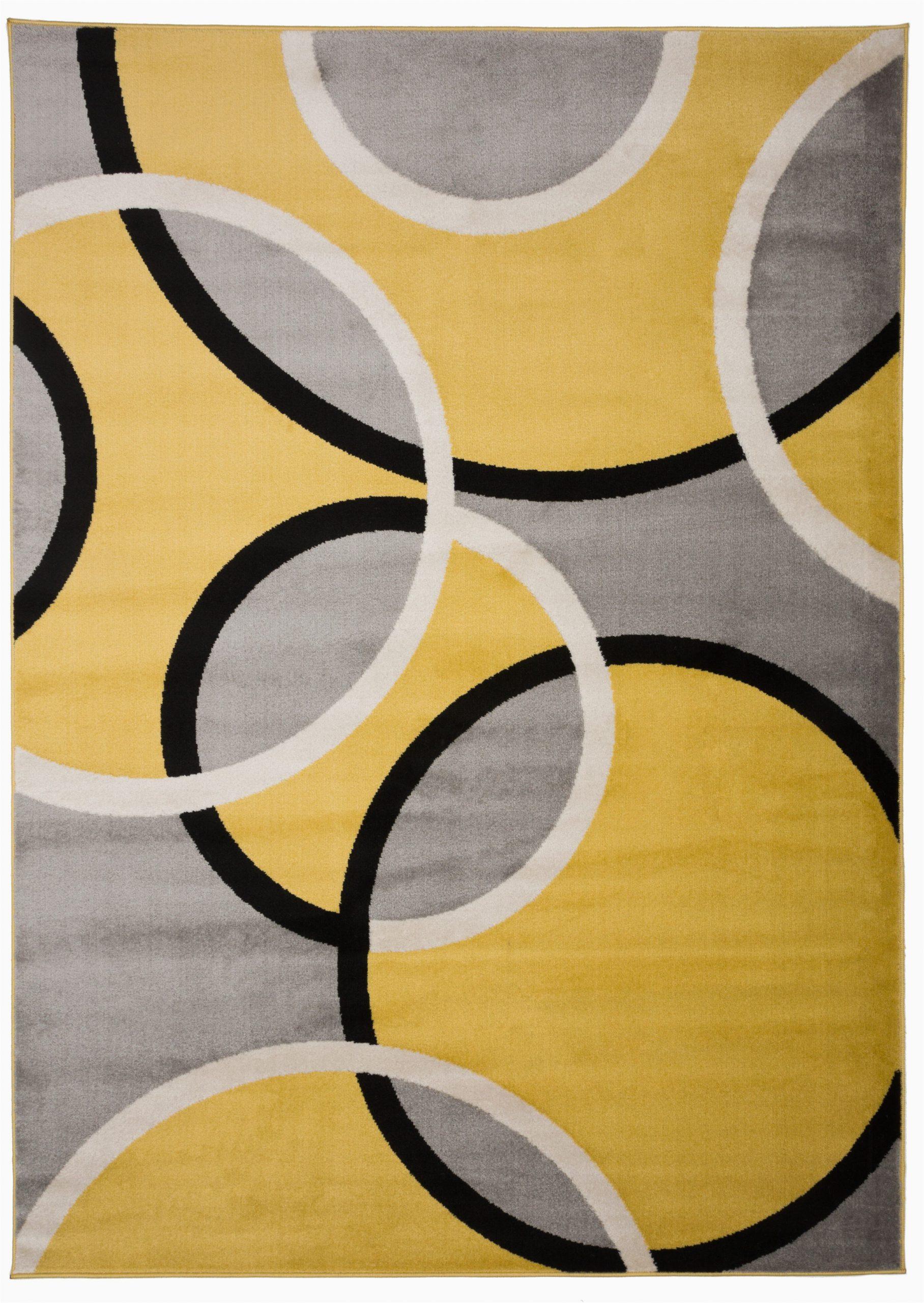dibella geometric yellow area rug