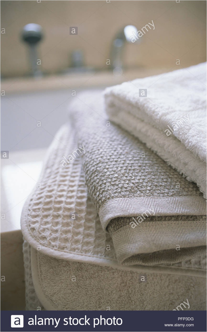 Organic Cotton Bath Rug Folded organic Cotton towels and Bath Mats Close Up Stock