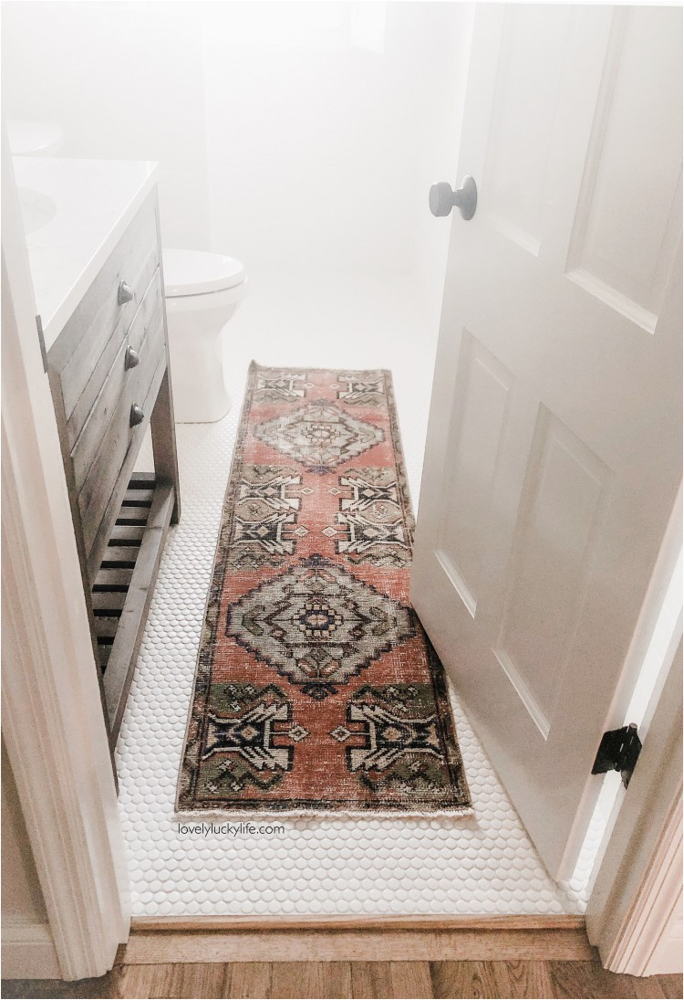 vintage turkish rug in bathroom copy