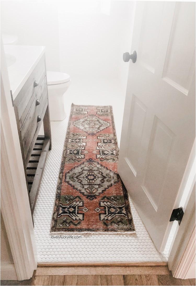 vintage turkish rug in bathroom copy