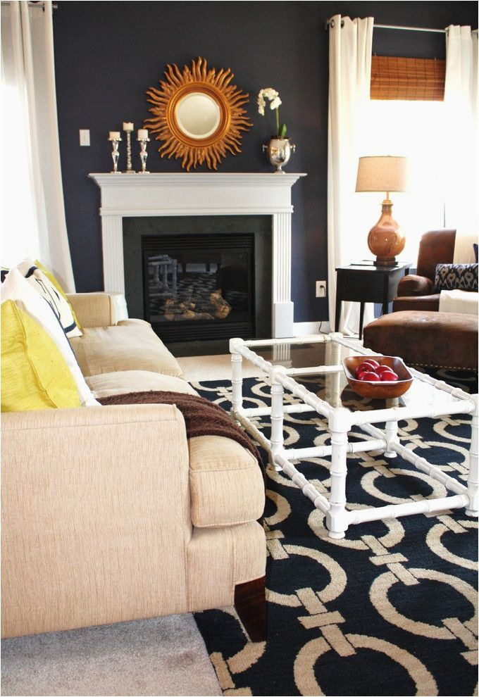 home depot woodbridge va with transitional living room and area rug dark walls glass coffee table key rug navy blue walls sunburst mirror white wood wood molding