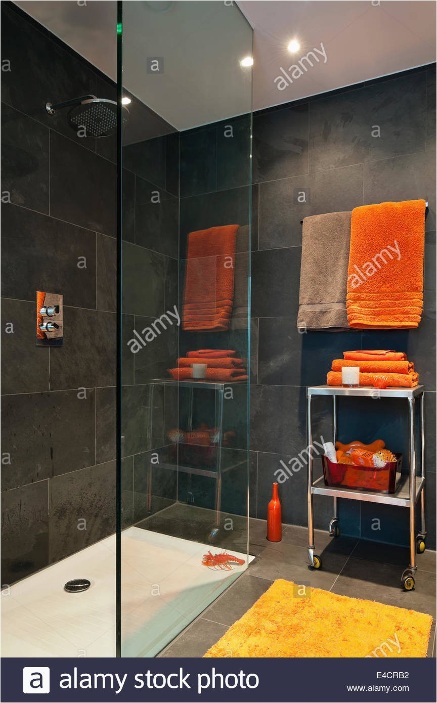 bright orange towels in bathroom with slate tiles E4CRB2