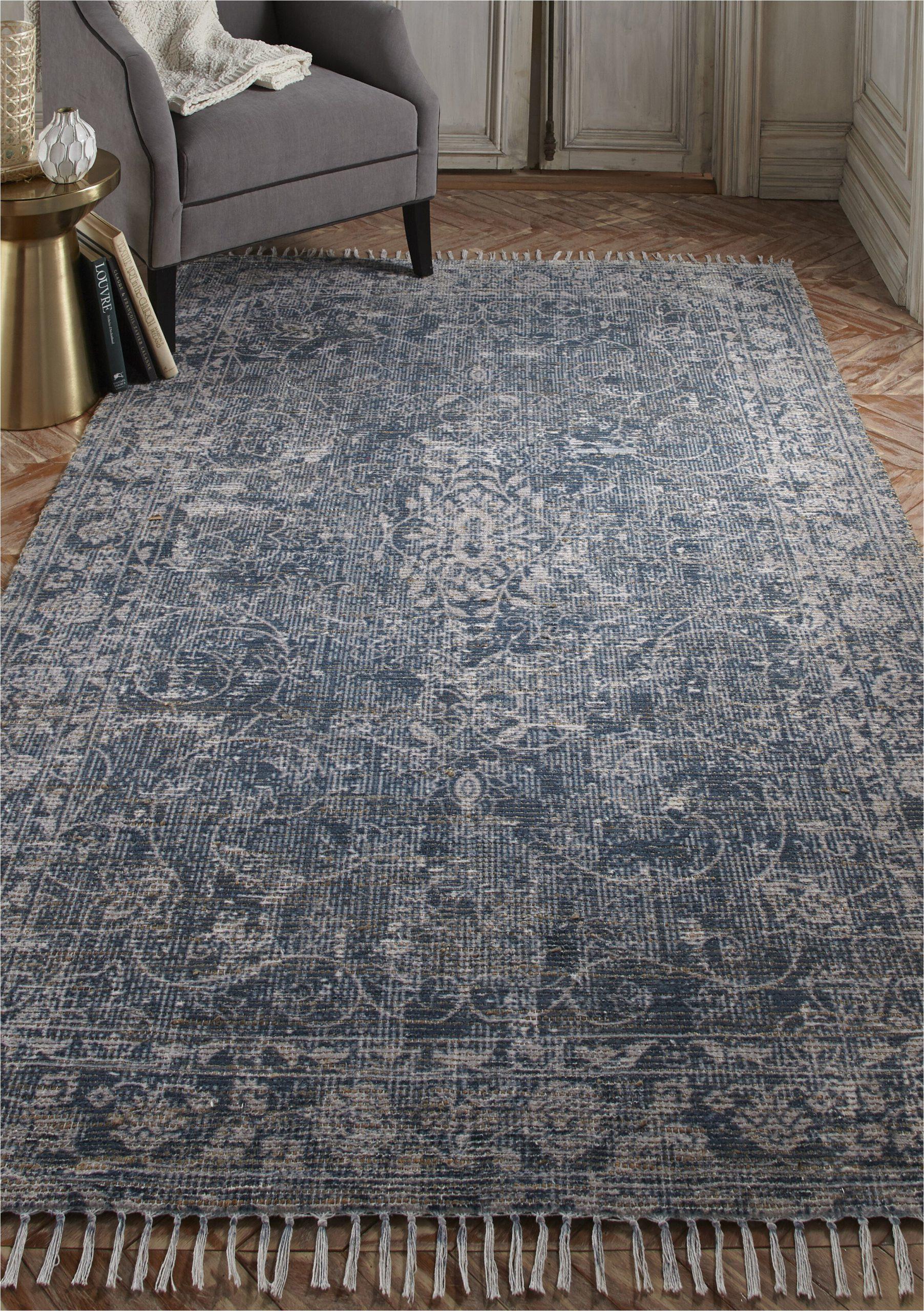 myrick hand knotted bluetan area rug