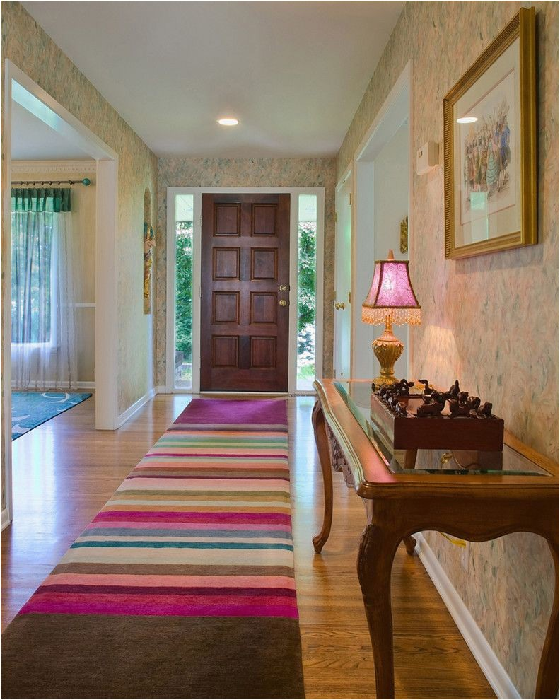 jordans furniture rugs eclectic entry also area rug carpet runner console table entry jewel tones runner sheer curtain panels side lites striped rug table lamp wallpaper white painted trim wood floor wool rug