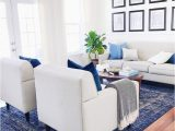 Blue and White Rug Living Room Coastal Living Room Design with White sofa and Blue Rug