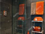 Bright orange Bath Rugs Bright orange towels In Bathroom with Slate Tiles Stock