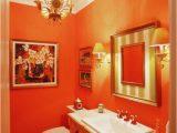 Bright orange Bath Rugs orange Powder Room with Chandelier and Bright Artworks