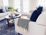 Rug with Blue Accents Living Room with Blue Accents Velvet Pillows and Vintage