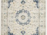 Safavieh Evoke Vintage Ivory Blue Distressed Rug Evoke Collection 6 7 X 9 Rug In Ivory and Blue Safavieh